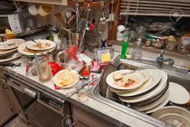 Dirty Dishes Over Flowing In A Kitchen Sink Stock Photo Picture - Dirty kitchen sink