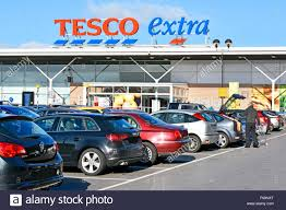 tesco womens boots uk supermarket tesco car park shopper loading trolley contents