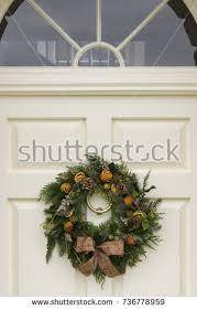 christmas decorations on porch light stock photo 79749727