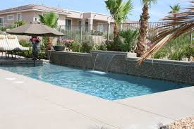 fabulous stacked stones waterfall pool ideas with umbrella patio