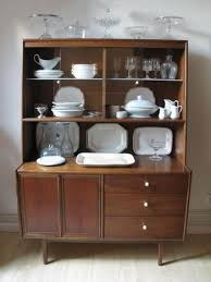 1940s vintage hutch with vintage plates serving ware and