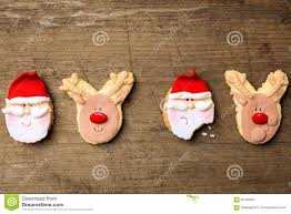 funny christmas cookies santa and reindeer on background