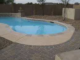 acrylic lace pool deck with travertine border concrete paver