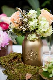 jar floral centerpieces oak nature center wedding gold jars floral