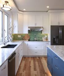 white kitchen cabinets with blue island photo 8 of 28 in passive house in corvallis oregon