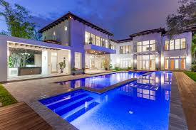 back exterior evening with pool miami real estate works