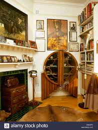 art deco cabinet in living room with old leather suitcases in