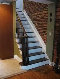 basement open staircase w brick accent wall casabelladesign