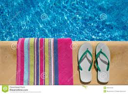flip flop towel pair of flip flop thongs and a towel on the side o stock photo