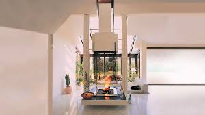 airy high ceiling living room with glass insert moder central