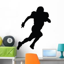 amazon com football silhouette style 38 peel and stick wall amazon com football silhouette style 38 peel and stick wall decals 12 in h x 9 in w home kitchen