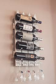 wooden wall mounted wine rack made to resemble a picket fence