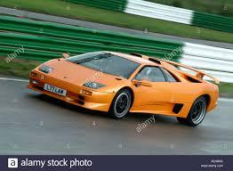 Lamborghini Murcielago Gtr - orange lamborghini murcielago italian sports car racing on a race