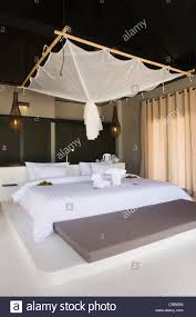 bed with a mosquito net in a luxury bungalow the sevenseas resort