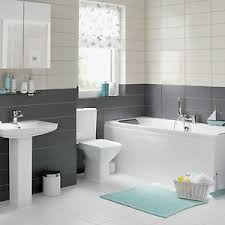 uk bathroom ideas a white unit bathroom with grey and white tiles and blue accessories