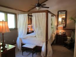 impressive wooden four poster bed with white curtain for tropical