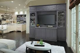Master Brand Cabinets Inc by Omega Cabinetry For A Family Room With A Glass Cabinet Doors And