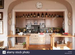 wooden work alcoved kitchen cooking area with large aga and wooden work