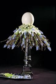 blue and purple flower arrangements symbolic and table