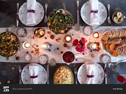 photos of thanksgiving dinner overhead view of a dining table set for thanksgiving dinner stock