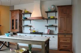 kitchen style white and stained cabinets decorative range hood