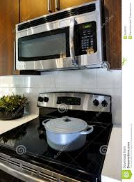modern kitchen stoves modern cooking appliances with microwave and stove stock photo