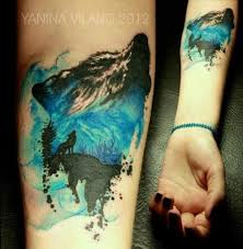 blue and black wolf tattoo on arm tattoomagz