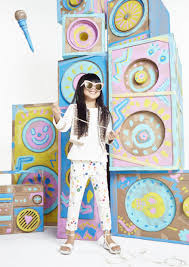 find paint splattered jeans and military style waistcoats in the