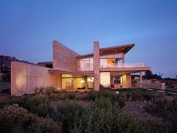 pre historic cross modern style stone building for a summer beach