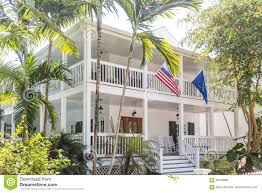American Flag House American Flag On White Wood House With Two Verandas Stock Photo
