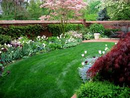 easy landscaping is paired with annuals in this colouful but low