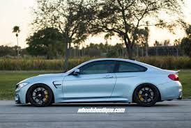 lowered cars and speed bumps bmw m4 tries on matte black wheels on a lowered body