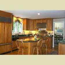 brown island la shaped kitchen cabinet with black granite