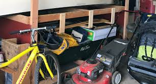 how maximize garage storage space the organized mom the best dual purpose storage garage tote top our off season tires perfect size and height for workbench