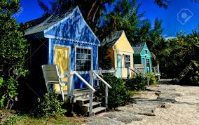 multi colored bungalows for a vacation paradise in the caribbean