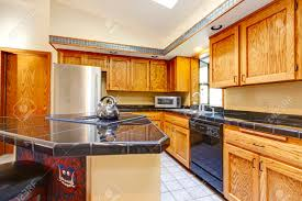 Light Brown Cabinets by Kitchen Black Counters Brown Cabinets Fabulous Home Design