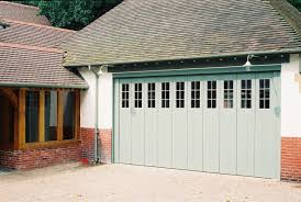 elegant sliding garage doors in natural colour amaza design sliding garage door ideas for a house with brick walls wooden framed windows and white painted