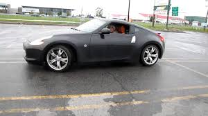 nissan 370z used 2010 nissan 370z 2010 black doing a wet 360 on a rainy day just for fun