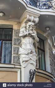 atlas figure on the italian embassy building on the old town of