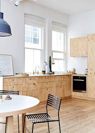 wooden furniture for kitchen cozy melbourne apartment with white walls and wooden furniture