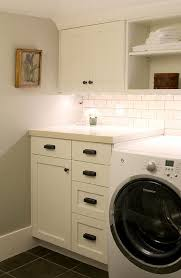 white laundry room cabinets with vintage bronze pulls