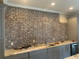 how to hang kitchen cabinets on brick wall s diy faux brick basement bar wall genstone