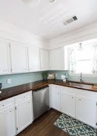 Choosing And Combining Countertops And Backsplashes Dark Blue - White kitchen cabinets with butcher block countertops