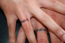 sweet memorable numeral wedding ring finger tattoo tattoomagz