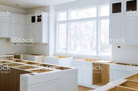 how to attach kitchen base cabinets wooden cabinets installation of in the white of installation base cabinets modular kitchen stock photo image now