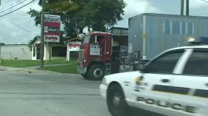 a crazy truck driver in old cab over semi truck in florida in