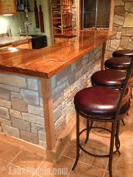 a diy home bar is easy to build with fake stone panels