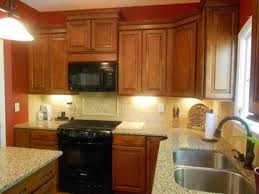 shenandoah cabinets vs kraftmaid kraftmaid cognac cabinets kitchen design ideas square in