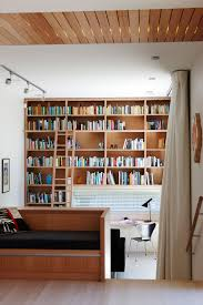 Bookcase With Ladder by Black Spiral Staircase For Second Floor Beside Brown Bookcase With