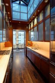 Modern Galley Kitchen Modern Galley Kitchen With High Ceiling And Wooden Cabinets With